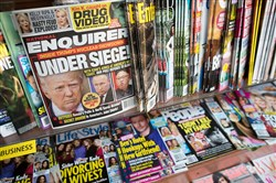 This file photo shows the cover of an issue of the National Enquirer featuring President Donald Trump at a store in New York. Karen McDougal, a former Playboy model who said she had a 10-month affair with President Donald Trump, settled her lawsuit Wednesday with the National Enquirer over an agreement that prohibited her from discussing the relationship publicly.