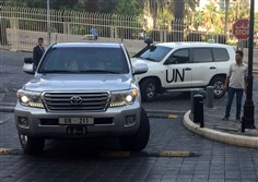 In this April 14, 2018, file photo, U.N. vehicles carrying the team of the Organization for the Prohibition of Chemical Weapons arrive at a hotel hours after the U.S., France and Britain launched an attack on Syrian facilities for suspected chemical attack against civilians, in Damascus, Syria.