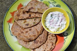 The Indian flatbreads, parathas, are stuffed with a spicy grated radish and with a cooling yogurt-based radish raitha.