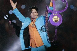In this Feb. 4, 2007 file photo, Prince performs during halftime of the Super Bowl XLI football game in Miami.