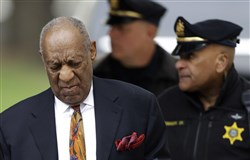 Bill Cosby, left, arrives for his sexual assault trial, Thursday at the Montgomery County Courthouse in Norristown, Pa.