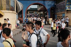 In this file photo, students exit Batasan Hills National High School in Quezon City, Philippines, on Aug., Aug. 7, 2015.