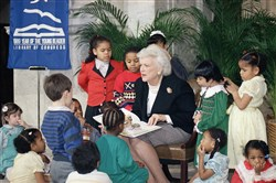 "First lady Barbara Bush reads to a group of day care students at the Library of Congress in Washington celebrating ""1989-Year of the Young Reader."""