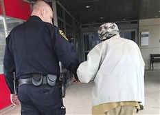 In this April 19, 2018, file photo, Jason Bentley, left, deputy chief of the department, escorts an 84-year-old man to see his wife, also 84, in the emergency department of UPMC Susquehanna hospital in Williamsport, Pa. after she had a medical emergency and was taken from the couple's home by ambulance. Montoursville Police Chief Jeff Gyurina said he gave the man a patrol car's cellphone number because the man couldn't drive anymore and had no family in the area to take him to the hospital.