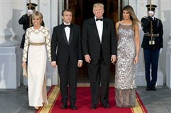 President Donald Trump, first lady Melania Trump, French President Emmanuel Macron and his wife, Brigitte, pose for photographs as they arrive for a state dinner at the White House in Washington on April 24, 2018.