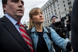 Actress Allison Mack leaves U.S. District Court for the Eastern District of New York after a bail hearing April 24, 2018, in the Brooklyn borough of New York City.