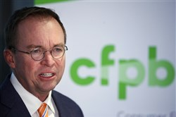 In this November 2017 photo, Mick Mulvaney speaks during a news conference after his first day as acting director of the Consumer Financial Protection Bureau in Washington.