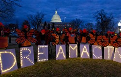 In this Jan. 21, 2018, file photo, demonstrators rally in support of Deferred Action for Childhood Arrivals outside the Capitol in Washington.