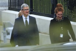 Apple CEO Tim Cook walks to the White House in Washington on April 25, 2018.