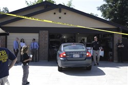 A car is backed out of the garage of a home searched in connection with the arrest of a man on suspicion of murder, April 25, 2018, in Citrus Heights, Calif.