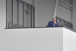 Jim Rutherford watches Penguins practice April 25 in Cranberry.