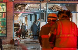 Police and emergency personnel investigate the scene after a vehicle drove through a BoRics salon in Brentwood Towne Center Tuesday night, injuring eight people.