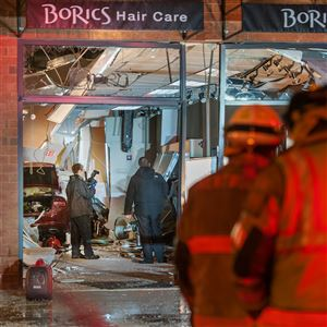 Emergency personnel investigate the scene after a vehicle drove through BoRics Hair Care, injuring eight people including the driver, on April 24, 2018, at Brentwood Towne Square in Brentwood.