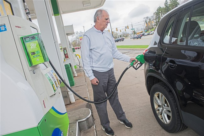 Bob Booth of McCandless pumps gas to his SUV at BP Gas Station on Wednesday, April 25 in McCandless. The state DEP announced that it will cease enforcement of the decades-old mandate that gas stations in the Pittsburgh region have to use a special, less-polluting blend of gasoline in the summer.