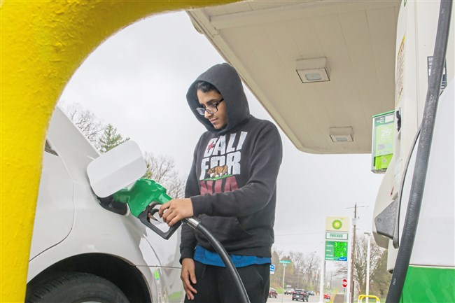 Mohammed Alahmadi, 24, of Wexford pumps gas to his car at BP Gas Station in McCandless in April.