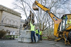 Pittsburgh public works crews remove the Stephen Foster statue in Schenley Plaza in Oakland on Thursday morning.