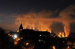 The glowing steam from the U.S.Steel's Edgar Thompson Works serves as a backdrop to St. Brendan in Braddock.