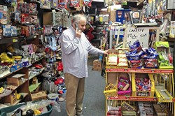 Marc Haber takes a call during one of his last days as owner of Murray Avenue Toys & News in Squirrel Hill. He bought the store 37 years ago when it told more than 1,000 newspapers every Sunday. Over the years, he said, he had to reinvent himself.