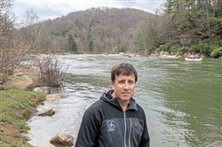 Eric Martin, CEO of Wilderness Voyageurs Rafting & Bike Tours, poses for a portrait on the Youghiogheny River on Saturday, April 28, 2018 in Ohiopyle.