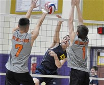 Norwin's Noah Gross, a junior outside hitter, goes up for a kill shot against two Bethel Park defenders earlier this season at the Plum tournament.