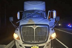 The truck's windshield is seen damaged by a 10-foot section of electrical conduit that struck the driver in the head, killing him, on Feb. 21, 2018. The conduit broke away from the ceiling of the Lehigh Tunnel along the Pennsylvania Turnpike in Lehigh County, Pa.