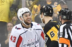 Capitals forward Tom Wilson laughs at Jamie Oleksiak during the Eastern Conference semifinals.