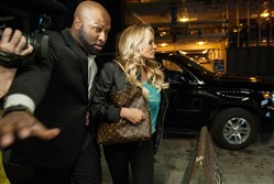 Adult film actress Stormy Daniels is rushed into Blush by a bodyguard as she arrives to perform in her first of two nights of shows in Downtown Pittsburgh.