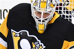 Matt Murray makes a save on Washington's Jay Beagle in Game 4 of the Eastern Conference semifinals.