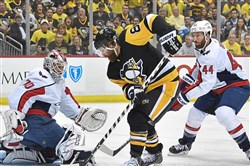 Braden Holtby makes a save on the Penguins' Phil Kessel.