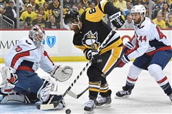 Washington's Braden Holtby makes a save on Phil Kessel in the Eastern Conference semifinals.