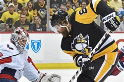 Capitals goaltender Braden Holtby makes a save on Phil Kessel during Monday's 2-1 Penguins loss. Kessel's future with the Penguins is just one important questions the Penguins face heading into the offseason.