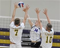 Mike Goga, a senior middle hitter at Baldwin, goes up for a shot against Deer Lakes' Tyler Osselborn (7) and Shane Yarussi (10) earlier this season.