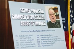 A poster displayed during the May 8 announcement by Attorney General Josh Shapiro of charges against the Rev. David Poulson.