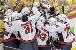 Capitals teammates celebrate after defeating the Penguins in overtime in game 6 of the second-round playoff series against the Washington Capitals, Monday, May 7, 2018 at PPG Paints Arena.