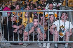 From left to right in front: Kullen Basko, 22, Ryan Bickert, 19, and Patrick Banze, 19, all of the North Side, react as they watch the Penguins in Game 6 Monday night.