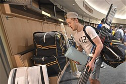Winger Jake Guentzel leaves the UPMC Lemieux Sports Complex in Cranberry after packing up his locker Wednesday.
