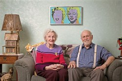 "This 2012 photo shows the late Paul and Anne Warhola in their West Homestead living room. On the wall behind them is a silkscreen, ""Double Marilyn,"" that Andy Warhol made soon after Marilyn Monroe died in August 1962."
