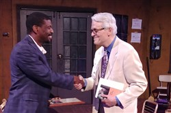 "Ekundayo Bandele of Hattlioo Theatre in Memphis accepts the August Wilson American Century Cycle Award from Post-Gazette senior theater critic Christopher Rawson on the set of ""Jitney."""