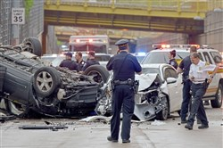 Pittsburgh police and emergency responders investigate a crash that closed the 10th Street Bypass on Saturday, May 12, 2018. The crash occurred under the Sixth Street Bridge.