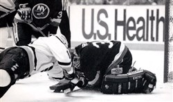 Penguins center Ron Francis lunges at Islanders goalie Glenn Healy during the third period of Game 7. The Penguins were trying to tie the game at the time.