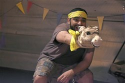 "Don Key the dancing burro (on the hand of performer Parag S. Gohel) is one of the welcoming puppets in ""The Forest of Everywhere,"" an immersive experience geared toward children with autistic sensory disorder, at 937 Liberty Ave., Downtown, through June 3."