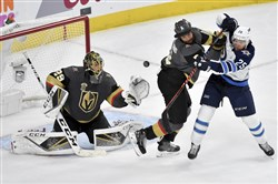 Marc-Andre Fleury makes one of his 33 saves on Wednesday night against Winnipeg.