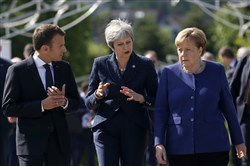 German Chancellor Angela Merkel, right, with French President Emmanuel Macron, left, and British Prime Minister Theresa May on the sidelines of the EU-Western Balkans summit in Bulgaria, May 17.
