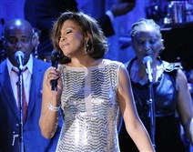 In this Feb. 13, 2011, file photo, singer Whitney Houston performs in Beverly Hills, Calif.
