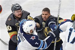 Ryan Carpenter, left, and Ryan Reaves fight with Winnipeg's Ben Chiarot during Game 3 of the Western Conference final.
