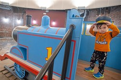 Henry Benter, 3, of the Strip District, explores the new Thomas & Friends exhibit on Thursday at the Children's Museum of Pittsburgh on the North Side. It officially opens Saturday.