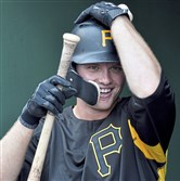 Pirates center fielder Austin Meadows gets his gear during batting practice before taking on the Padres Friday.