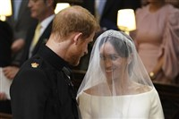 Britain's Prince Harry and Meghan Markle hold hands during their wedding ceremony oin St. George's Chapel in Windsor Castle in Windsor, near London, England, Saturday, May 19, 2018.