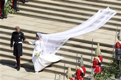 Britain's Prince Harry and Meghan Markle leave after their wedding ceremony at St. George's Chapel.
