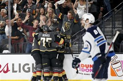 Tomas Nosek celebrates with his teammates after scoring a goal Friday. (John Locher/Associated Press)